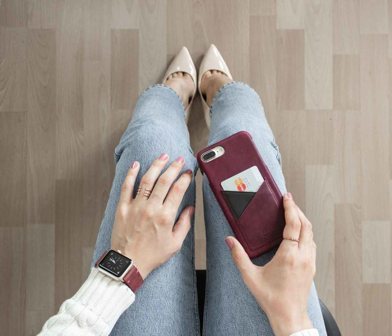 Colonial-Red-and-GrapeVine-Iphone-8-plus-leather-case-on-top-of-a-jeans-for-woman-bs