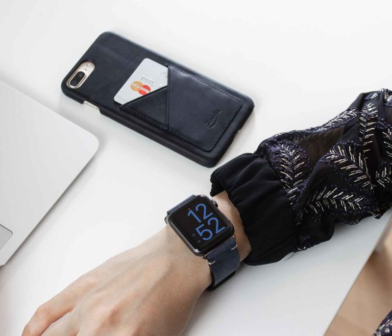 Cosmos-IPhone-8-plus-blue-leather-case-on-a-white-murmle-matches-a-blue-woman-outfit