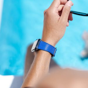 Deep-Ocean-Apple-watch-blue-rubber-band-with-a-swimming-pool-behind