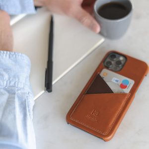 Barrel-iPhone-12-pro-max-light-brown-leather-case-on-top-of-a-marble
