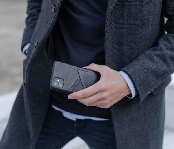 Carbon-Core-iphone11-black-leather-case-for-him-with-a-grey-coat