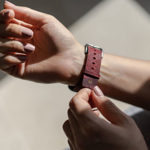 AW-bullet-proof-red-leather-band-with-focus-on-monogram