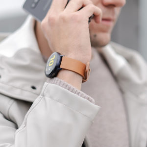 galaxy-watch-active-tawny-on-wrist-for-him-close-to-a-grey-coat