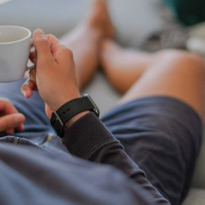 Apple-watch-black-tide-band-recycled-ocean-plastic-man-sportwear-outfit-on-sofa