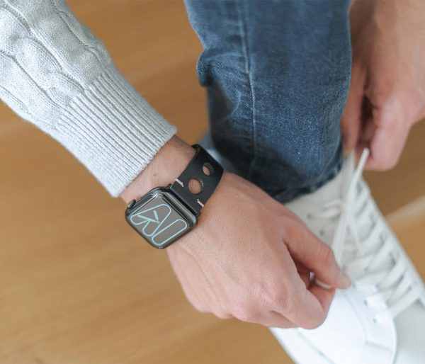 AW black full grain leather band for man handling his white shoes